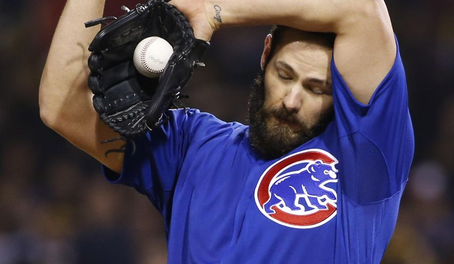 Chicago Cubs starting pitcher Jake Arrieta wipes his head as he pitches to the Pittsburgh Pirates in the sixth inning of the National League wild card baseball game Wednesday, Oct. 7, 2015, in Pittsburgh. (AP Photo/Gene J. Puskar)