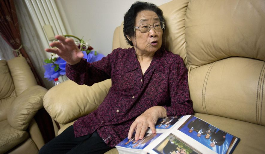 Chinese Nobel Prize winner Tu Youyou gestures while speaking during an interview in her apartment in Beijing, Wednesday, Oct. 7, 2015. Tu, along with scientists from Ireland and Japan, won the 2015 Nobel Prize in medicine on Monday for discovering drugs against malaria and other parasitic diseases that affect hundreds of millions of people every year. In 1971, Tu successfully extracted from sweet wormwood an active ingredient that should be known as artemisinin, which turned out to be an effective cure of malaria. She became the first Chinese scientist to win a Nobel prize in science for work done in China and the first Chinese woman to win any Nobel prize. (AP Photo/Mark Schiefelbein)