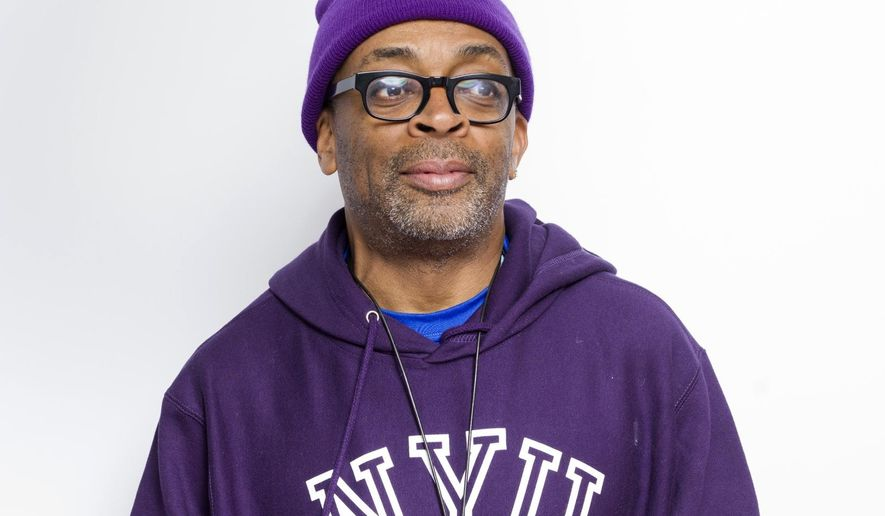 FILE - In this Jan. 25, 2015 file photo, writer-director Spike Lee poses for a portrait during the Sundance Film Festival in Park City, Utah. Filmmaker, teacher, honorary Oscar winner, and crazy New York sports fan, Lee is the next grand marshal of the New York City Marathon, race officials announced, Monday, Oct. 5, 2015. (Photo by Victoria Will/Invision/AP, File)