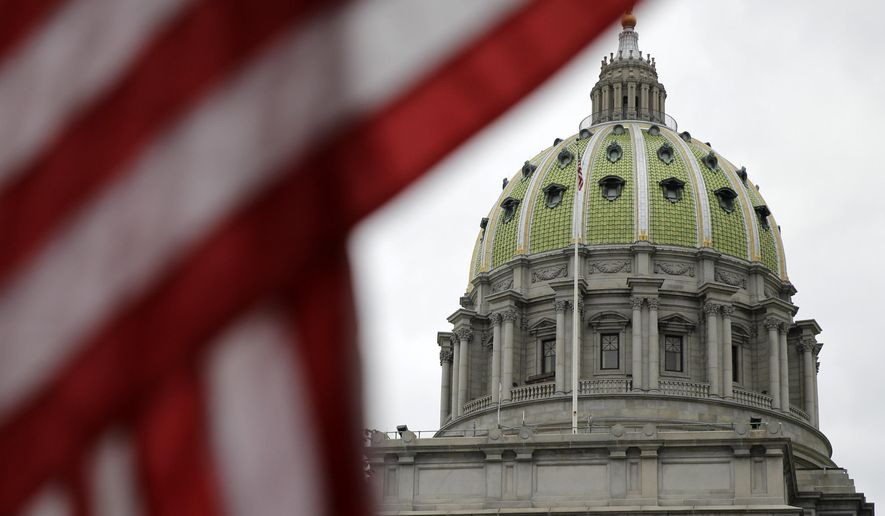 The Pennsylvania Capitol building is shown Wednesday, Oct. 7, 2015, in Harrisburg, Pa. Gov. Tom Wolf's tax proposal is being debated in the state House of Representatives in the first-term Democrat's effort to break Pennsylvania's 3-month-old budget impasse. (AP Photo/Matt Rourke)