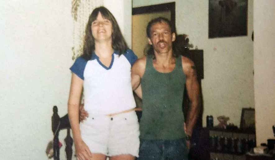 """In this undated photo provided by Tony Chumbley, Virginia """"Jenny"""" Chumbley and Chris Chumbley are pictured at a home in London, Ky., around 2005. Chris Chumbley is set to plead guilty to manslaughter in his wife's 2013 shooting death, but Chumbley has maintained that Jenny Chumbley had asked him to end her life after a long battle with cancer. (Courtesy of Tony Chumbley via AP)"""