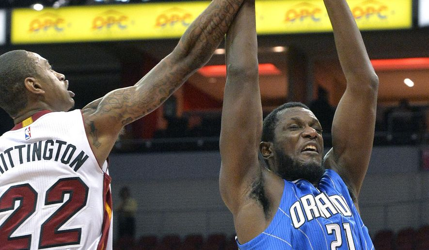 Orlando Magic's Nnanna Egwu (21), fights Miami Heat's Greg Whittington (22) for a rebound during the second half of an NBA preseason basketball game, Wednesday, Oct. 7, 2015, in Louisville, Ky. Orlando defeated Miami 100-97. (AP Photo/Timothy D. Easley)