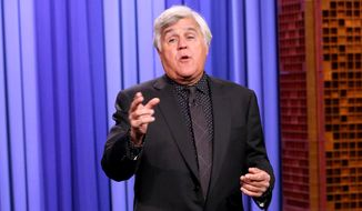 "In this Oct. 6, 2015 photo released by NBC, comedian and former late night talk show host Jay Leno delivers the opening monologue on ""The Tonight Show Starring Jimmy Fallon,"" in New York. (Douglas Gorenstein/NBC via AP)"