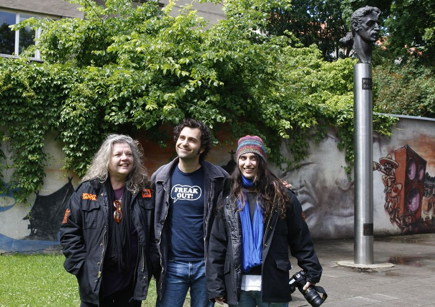 FILE - In this June 4, 2009 file photo, the family of late musician Frank Zappa, wife Gail, from left, son Dweezil and daughter Diva, stand near by the Frank Zappa statue, in Vilnius, Lithuania. Gail Zappa, has died at her Los Angeles home at age 70. Family spokeswoman Marcee Rondan says Zappa was surrounded by her children when she died Wednesday, Oct. 7, 2015. (AP Photo/Mindaugas Kulbis, File)
