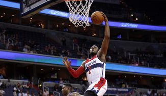 Washington Wizards guard John Wall (2) dunks in the second half of an NBA preseason basketball game against the Philadelphia 76ers, Tuesday, Oct. 6, 2015, in Washington. The Wizards won 129-95. (AP Photo/Alex Brandon)