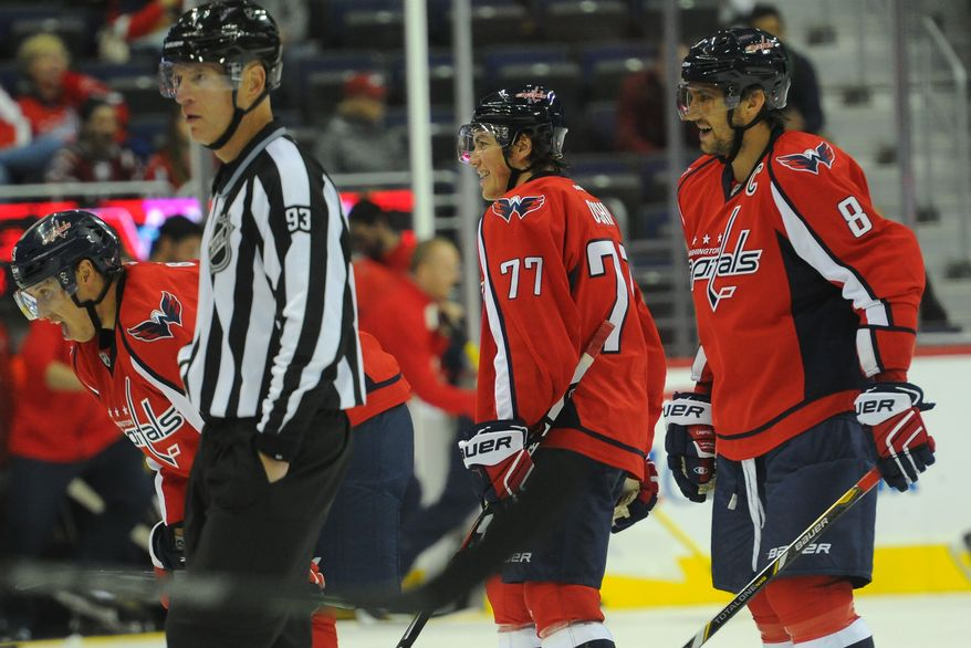 Washington Capitals right wing T.J. Oshie (77) and  left wing Alex Ovechkin (8) at the Verizon Center, Oct. 2, 2015, in Washington, D.C. (Preston Keres/Special to The Washington Times)