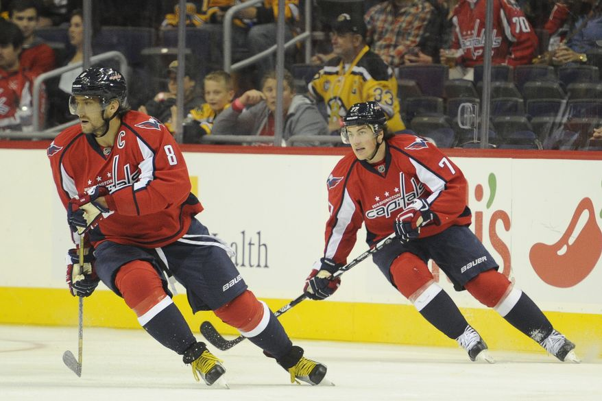 Washington Capitals left wing Alex Ovechkin (8) and right wing T.J. Oshie (77) at the Verizon Center, Oct. 2, 2015, in Washington, D.C. (Preston Keres/Special to The Washington Times)