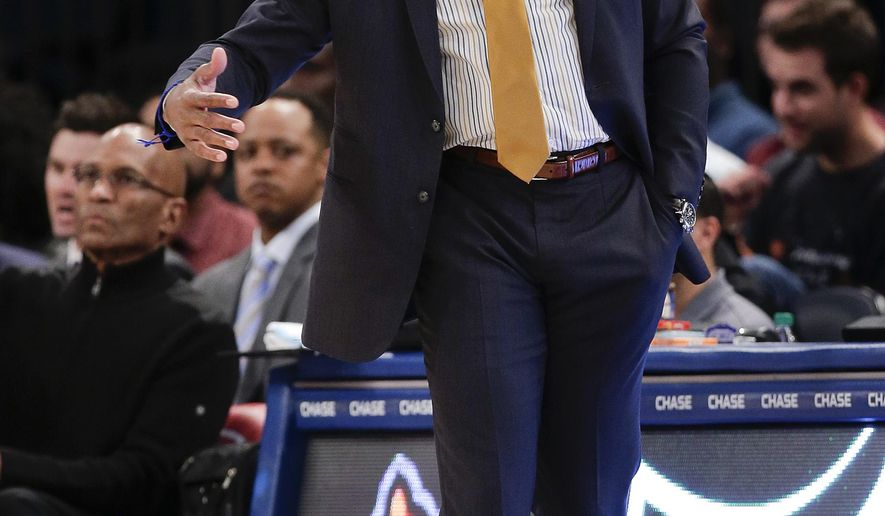 New York Knicks head coach Derek Fisher motions to a referee during the second quarter of a preseason exhibition basketball game against Paschoalotto Bauru, Wednesday, Oct. 7, 2015, in New York. (AP Photo/Julie Jacobson)