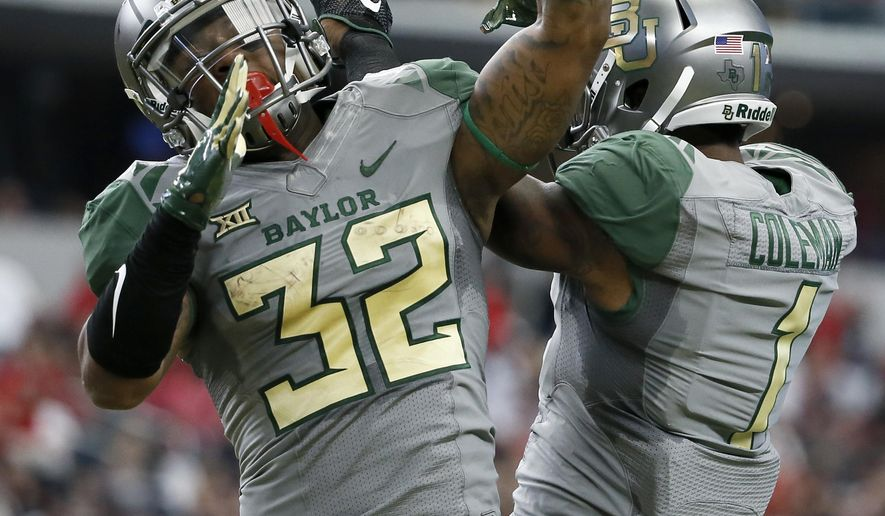 Baylor running back Shock Linwood (32) and wide receiver Corey Coleman (1) celebrate a touchdown scored by Linwood in the first half of an NCAA college football game a giants Texas Tech Saturday, Oct. 3, 2015, in Arlington, Texas. (AP Photo/Tony Gutierrez)