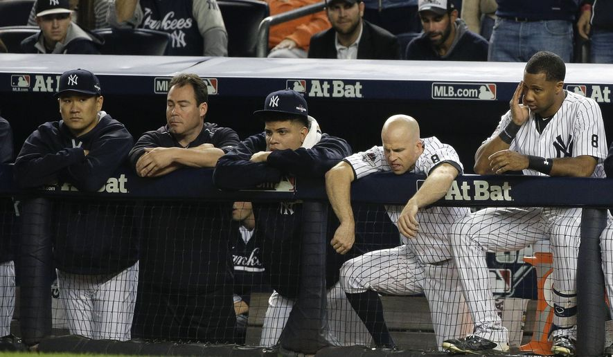 New York Yankees pitcher Masahiro Tanaka, far left, Dellin Betances, second from left, Brett Gardner, second from right, and Chris Young, right, watch from the dugout against the Houston Astros during the ninth inning of the American League wild card baseball game, Tuesday, Oct. 6, 2015, in New York. The Astros won 3-0 to advance to the American League Division Series. (AP Photo/Julie Jacobson)