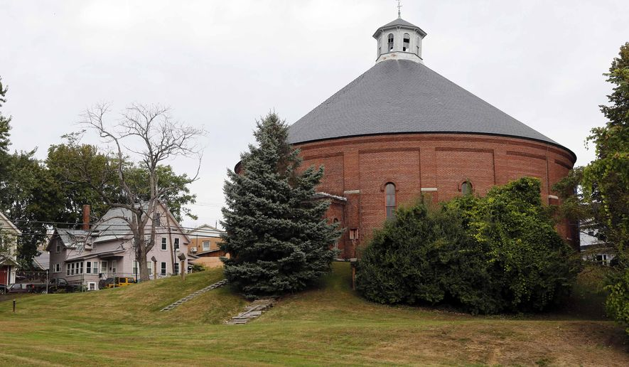 This Oct. 2, 2015 photo, shows the Concord gasholder building, built in 1888 in Concord, N.H. After the roof was damaged during a storm in 2013, the building was temporarily repaired and now historians and preservation experts worry that without permanent repairs, and soon, the building is doomed to the rubble pile. (AP Photo/Jim Cole)