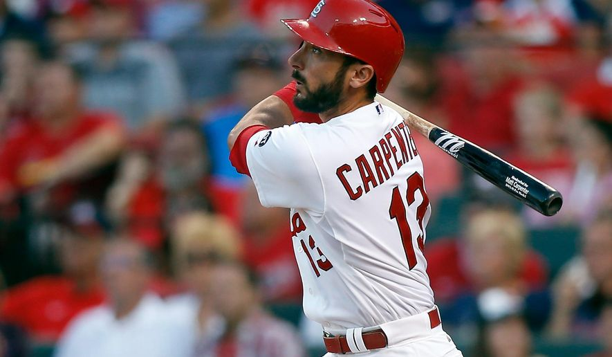 FILE - In this July 31, 2015, file photo, St. Louis Cardinals' Matt Carpenter watches his solo home run during the first inning of a baseball game against the Colorado Rockies in St. Louis. Carpenter really muscled up this season. The St. Louis Cardinals leadoff man hit 28 homers, more than his first three major league seasons combined. (AP Photo/Scott Kane, File)