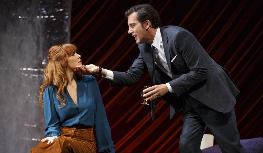 """In this image released by Polk & Co., Kelly Reilly, left, and Clive Owen appear during a performance of Harold Pinter's """"Old Times."""" (Joan Marcus/Polk & Co. via AP)"""