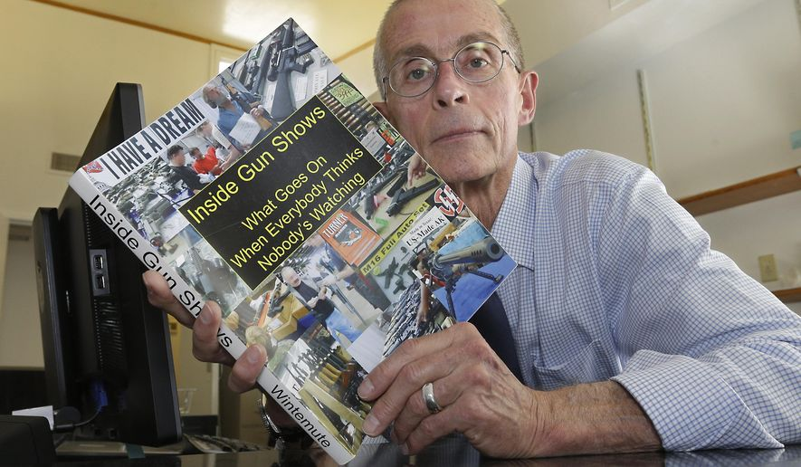 ADVANCE FOR USE MONDAY, OCT. 12, 2015 AND THEREAFTER - In this Oct. 6, 2015 photo, Dr. Garen Wintemute poses with a copy of a study he did on gun shows, at his office at the University of California Davis Medical Center in Sacramento, Calif. Wintemute, an emergency doctor, who is board certified in family practice, is a long-time national leader in gun violence, having researched gun accessibility, connections between gun ownership and violence. (AP Photo/Rich Pedroncelli)
