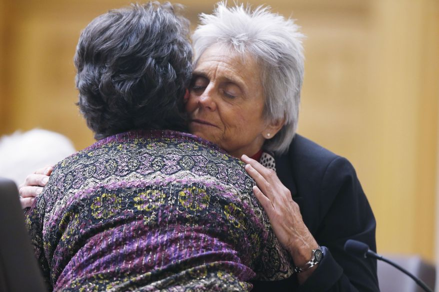 FILE - In this Feb. 6, 2015 file photo, Colorado Rep. Joann Ginal, right, D-Fort Collins, hugs Carol Stork of Delta, Colo., after her testimony about the death of her terminally-ill husband Albert, during a Colorado legislative hearing on a bill proposal by Ginal that would give dying patients the option to seek help ending their lives, in Denver. Colorado Democrats will consider legislation in 2016 to allow terminally ill patients to end their lives with doctor-prescribed medication. A similar proposal last year failed, with opposition from both parties, but supporters of the idea are hoping California's passage of right-to-die legislation will give momentum to their cause. (AP Photo/David Zalubowski, file)