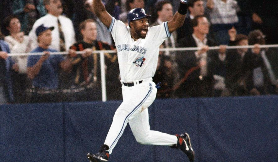 FILE - In this Oct. 23, 1993, file photo, Toronto Blue Jays' Joe Carter celebrates his game-winning, three-run home run in the ninth inning of Game 6 of the World Series in Toronto. It may not have been obvious at the time, but when Joe Carter's home run sailed over the wall to win the 1993 World Series for Toronto, a distinct era in baseball history came to an end. (AP Photo/Mark Duncan, File)