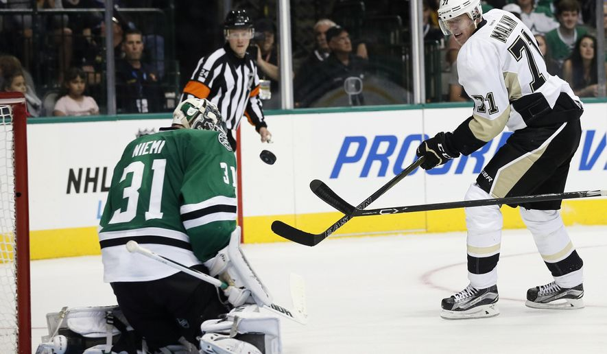 Dallas Stars goalie Antti Niemi, of Finland, blocks a shot by Pittsburgh Penguins center Evgeni Malkin (71), of Russia, in the second period of an NHL hockey game Thursday, Oct. 8, 2015, in Dallas. (AP Photo/Tony Gutierrez)