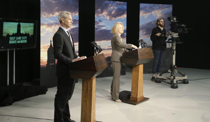 Mayor Ralph Becker, left, and former state representative Jackie Biskupski, center, are shown during a Salt Lake City Mayor debate at the studios of KUED-TV Thursday, Oct. 8, 2015, in Salt Lake City. Becker and challenger Biskupski covered issues ranging from the renovation of the airport to police dealings with the homeless. (AP Photo/Rick Bowmer)