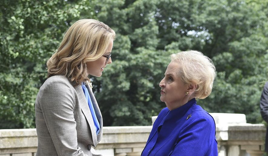 """In this image released by CBS, former Secretary of State Madeleine Albright, right, appears in a scene with actress Tea Leoni, who portrays U.S. Secretary of State Elizabeth McCord in an episode of """"Madam Secretary."""" Albright, 78, took a break from teaching duties at Georgetown University to film a guest shot on the show, airing Sunday, Oct. 11, at 8 p.m. EDT on CBS. (Sarah Shatz/CBS via AP)"""