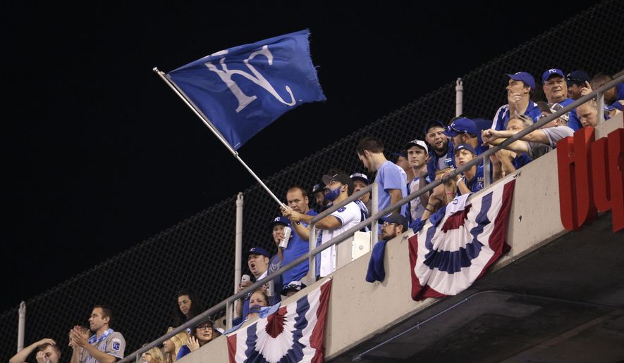 Kansas City Royals fans wave a flag during the sixth inning in Game 1 of baseball's American League Division Series between the Royals and the Houston Astros, Thursday, Oct. 8, 2015, in Kansas City, Mo. (AP Photo/Charlie Riedel)