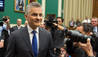 Lawmakers grilled Volkswagen of America CEO Michael Horn on Capitol Hill Thursday, pressing him on his company's emissions scandal. The U.S. subsidiary is also potentially facing billions in fines for violating the Clean Air Act, as well as state investigations and class-action lawsuits. (Associated Press Photographs)