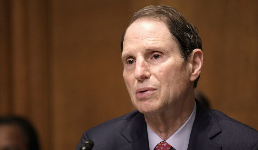 """""""The roll call of American gun tragedies is already far, far too long,"""" said Sen. Ron Wyden, one of 27 Democrats who called Thursday for stricter gun laws. (Associated Press)"""