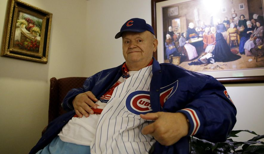 Longtime Chicago Cubs baseball fan Joseph Spreitzer, 72, sits in a coach at Little Sisters of the Poor, Thursday, Oct. 8, 2015, in Chicago. Winning it all has been a goal of the Cubs for a long, long time, of course. Their World Series drought dates to 1908, one of the longest in sports history, and there has been more heartbreak along the way than Heath or any other Cubs fan would care to remember.  (AP Photo/Nam Y. Huh)