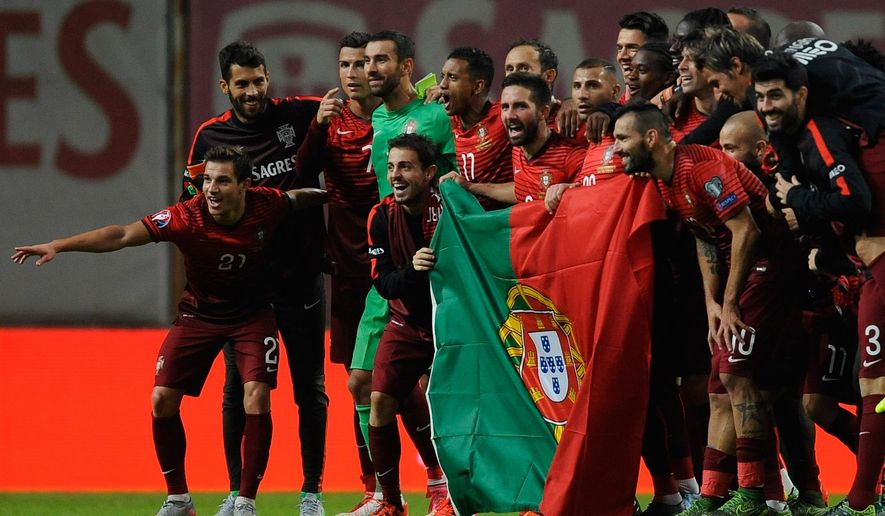 Portugal players celebrate at the end of the Euro 2016 qualifying group I soccer match between Portugal and Denmark at the Municipal Stadium in Braga, Portugal, Thursday, Oct. 8 2015. Portugal defeated Denmark 1-0. (AP Photo/Paulo Duarte)