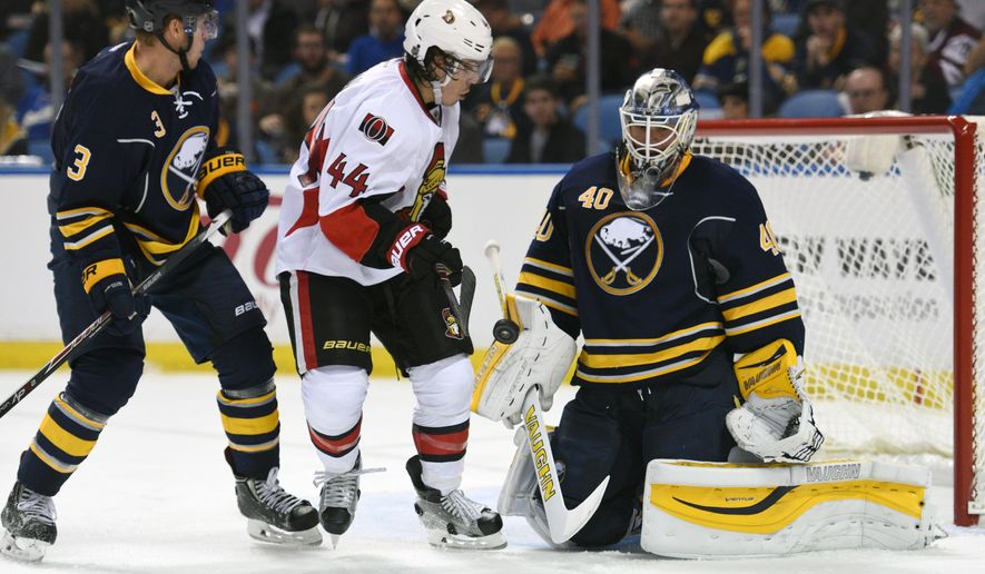 Buffalo Sabres defenseman Mark Pysyk (3) and Ottawa Senators center Jean-Gabriel Pageau (44) watch the blocker save from Sabres goaltender Robin Lehner (40) during the second period of an NHL hockey game, Thursday, Oct. 8, 2015, in Buffalo, N.Y. (AP Photo/Gary Wiepert)