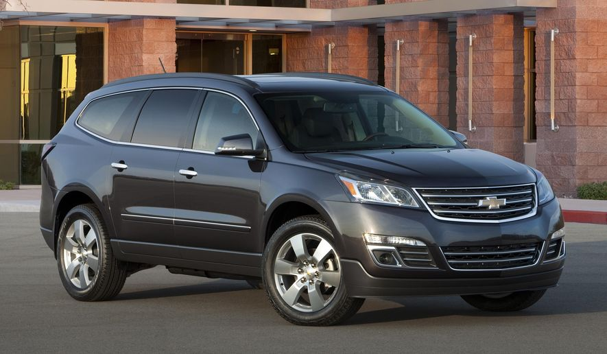 This undated photo provided by General Motors shows the 2016 Chevrolet Traverse LTZ. General Motors on Thursday, Oct. 8, 2015 said it is recalling nearly 32,000 Buick Enclave, Chevrolet Traverse and GMC Acadia SUVs from the 2016 model year because an electrical short could cause the wiper motor to catch fire. (General Motors via AP)