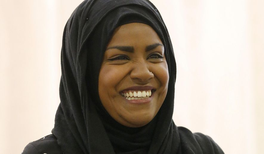 """""""The Great British Bake Off"""" TV show winner Nadiya Hussain smiles as she poses for photographers in London, Thursday, Oct. 8, 2015. Nadiya Hussain was crowned winner of the contest Wednesday on a program watched by 13.4 million people, one in five of the British population and the biggest TV audience of the year. (AP Photo/Frank Augstein)"""