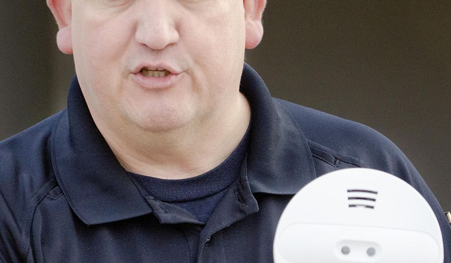 Sioux City Fire Department's Lt. Joe Rodriguez talks about smoke detectors during a smoke demonstration at Loess Hills Elementary School in Sioux City, Iowa on Wednesday, Oct., 7, 2015. The event by Sioux City Fire Rescue was part of fire prevention week activities. (Justin Wan/Sioux City Journal via AP)