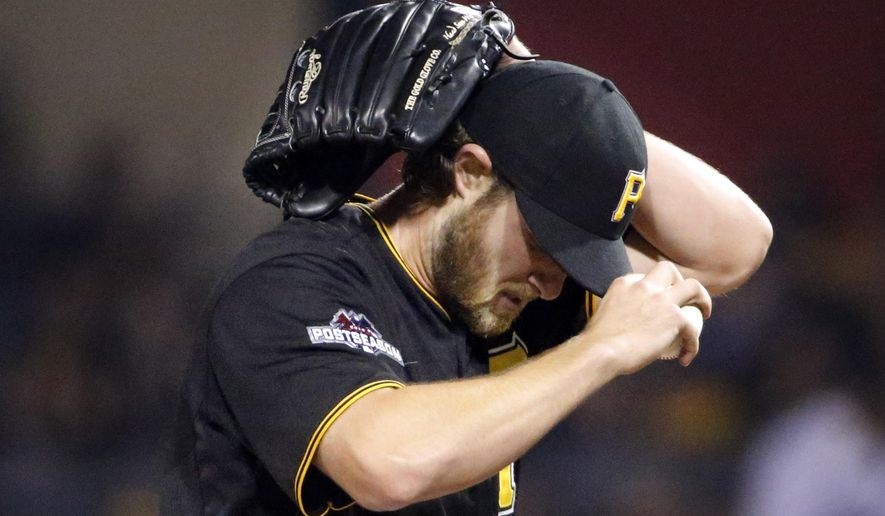 Pittsburgh Pirates starting pitcher Gerrit Cole adjusts his cap after giving up a solo home run to Chicago Cubs' Dexter Fowler in the fifth inning of the National League wild card baseball game, Wednesday, Oct. 7, 2015, in Pittsburgh. (AP Photo/Gene J. Puskar)