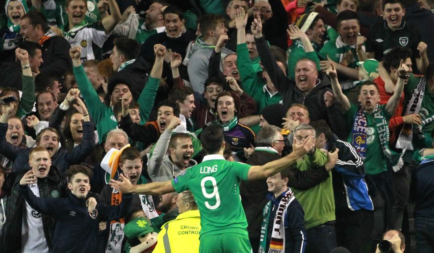 Ireland's Shane Long celebrates with fans after scoring the opening goal during the Euro 2016 group D qualifying soccer match between Ireland and Germany in Dublin, Ireland, Thursday, Oct. 8, 2015. (AP Photo/Peter Morrison)
