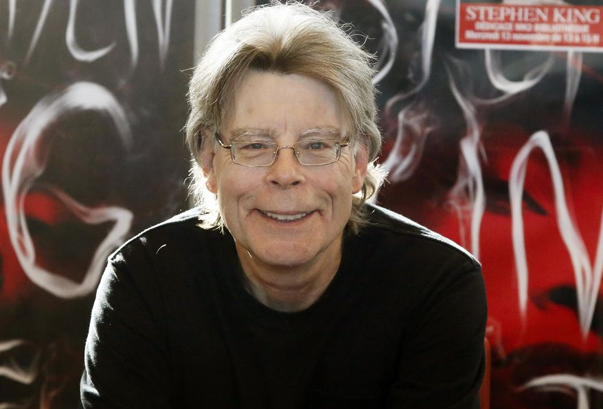 """In this Nov. 13, 2013, file photo, author Stephen King poses for the cameras, during a promotional tour for his novel, """"Doctor Sleep"""" in Paris. (AP Photo/Francois Mori, File)"""