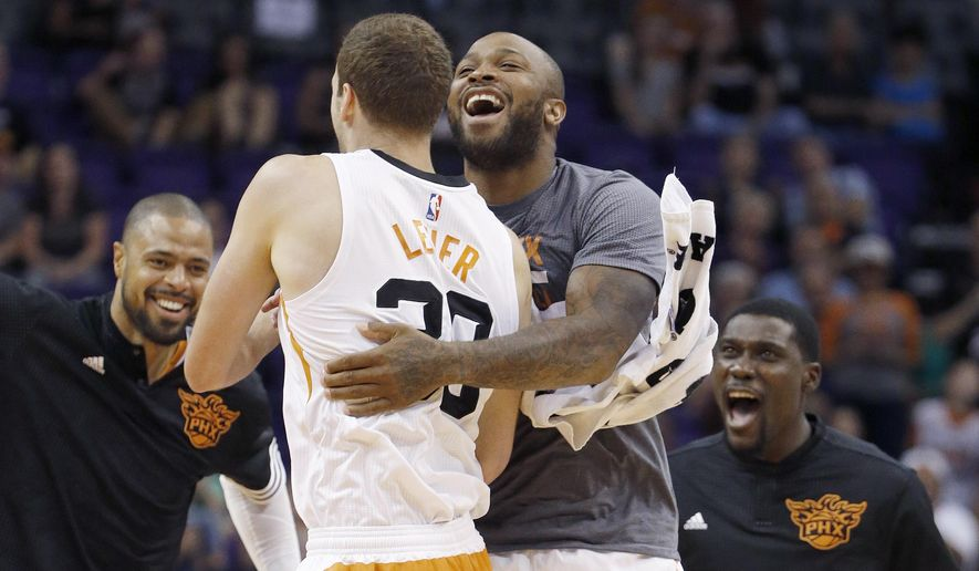Phoenix Suns' Jon Leuer, second from left, celebrates his dunk against the Sacramento Kings with teammates Tyson Chandler, left, Kyle Casey, right, and P.J. Tucker during the first half of an NBA preseason basketball game Wednesday, Oct. 7, 2015, in Phoenix. (AP Photo/Ross D. Franklin)