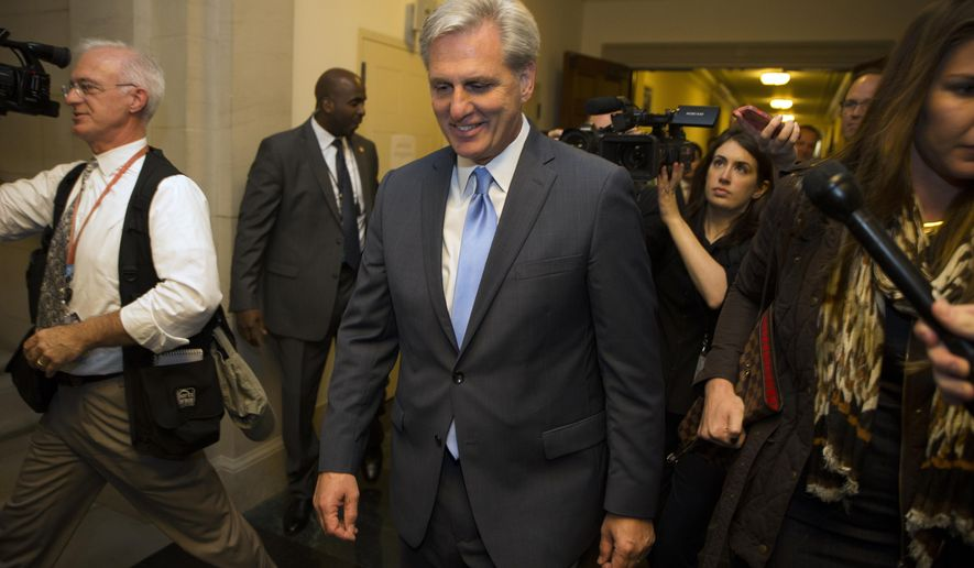 House Majority Leader Kevin McCarthy of Calif. walks out of nomination vote meeting on Capitol Hill in Washington, Thursday, Oct. 8, 2015, after dropping out of the race to replace House Speaker John Boehner, who is stepping down and retiring from Congress at the end of the month. (AP Photo/Evan Vucci)