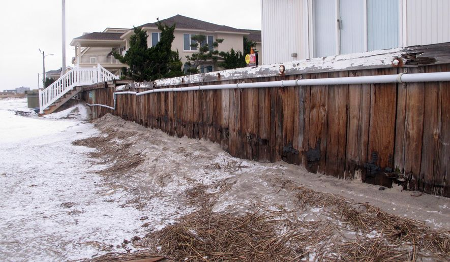 This Jan. 14, 2015 photo shows oceanfront homes in Margate N.J. behind a protective bulkhead that the town considers sufficient to protect against coastal storms. New Jersey officials went to court on Thursday Oct. 8, 2015 to seize 87 publicly owned beachfront parcels of land under eminent domain to be used for building protective sand dunes that Margate and its residents don't want. (AP Photo/Wayne Parry)