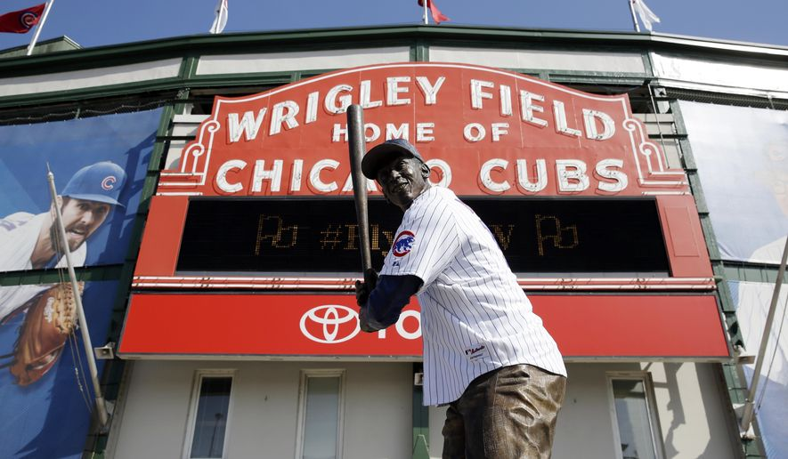 Ernie Banks' statue wears a Chicago Cubs jersey at Wrigley Field on Thursday, Oct. 8, 2015, in Chicago. The Cubs will face the St. Louis Cardinals in Game 1 of the National League Division Series on Friday. (AP Photo/Nam Y. Huh)