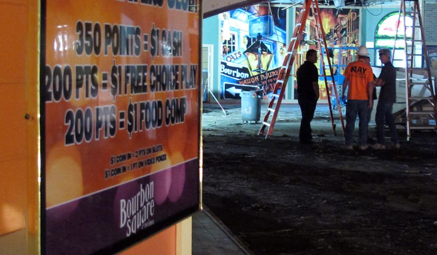 This Sept. 21, 2015 photo shows crews working inside the shuttered Bourbon Square Casino that is being renovated as part of a housing-retail project at Victorian Square in Sparks, Nev.  The city of Sparks has launched an ambitious urban renewal project with downtown apartments and retail space fueled by the dramatic growth in jobs and housing anticipated in the years ahead with the arrival of Tesla Motors, Switch and others (AP Photo/Scott Sonner)