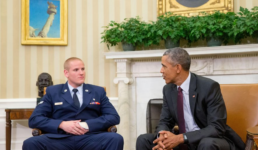 FILE - In this Sept. 17, 2015 file photo, President Barack Obama speaks to Air Force Airman 1st Class Spencer Stone in the Oval Office of the White House in Washington. An Air Force spokesman says Stone, who helped subdue an attacker on a French train in August, is in stable condition after being stabbed in California. (AP Photo/Andrew Harnik, File)
