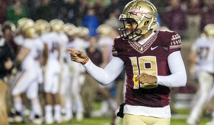 FILE - In this Nov. 22, 2014, file photo, Florida State kicker Roberto Aguayo celebrates after kicking the game-winning field goal with three seconds left in the second half of an NCAA college football game against Boston College in Tallahassee, Fla. Growing up in Mascotte, Florida, Roberto Aguayo and his brother would go outside and imagine it was the last second of the Florida State-Miami game with a field goal needed to win it. In a rivalry that is defined by kicks more than any other, Aguayo is hoping to not join the list of FSU kickers who have missed important kicks. (AP Photo/Mark Wallheiser, File)