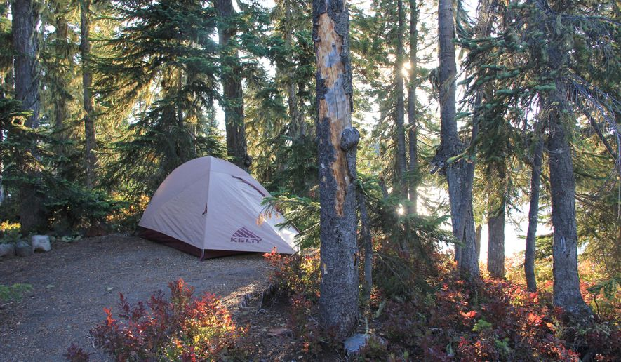 ADVANCE FOR WEEKEND EDITIONS, OCT. 10-11 - This photo taken Sept. 8, 2015, shows a camping spot on Berry Island on Summit Lake in the Deschutes National Forest near Oakride, Ore.  Summit Lake is one of the great secret places in the Cascade Mountains not just because of its islands, but also because of the clear water and views of Diamond Peak. (Zach Urness/Statesman-Journal via AP) MANDATORY CREDIT