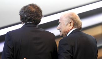 In this June 1, 2011, file photo Swiss FIFA President Joseph Blatter, right, and French UEFA President Michel Platini walk together at the 61st FIFA Congress in Zurich, Switzerland. (AP Photo/Michael Probst, file)