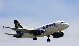 In June 2015 photo, a Spirit Airlines plane approaches Chicago O'Hare International Airport in Chicago.  (Bill Montgomery/Houston Chronicle via AP) MANDATORY CREDIT **FILE**