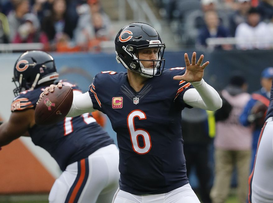 Chicago Bears quarterback Jay Cutler (6) throws a pass during the first half of an NFL football game against the Oakland Raiders, Sunday, Oct. 4, 2015, in Chicago. (AP Photo/Charles Rex Arbogast)