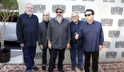 The group Los Lobos, from left, David Hidalgo, Louie Perez, Steve Berlin, Conrad Lozano and Cesar Rosas arrive at the Americana Music Honors and Awards show in Nashville, Tenn., in this Sept. 16, 2015, file photo. The band is being considered for induction next year in the Rock and Roll Hall of Fame. (AP Photo/Mark Zaleski, File)
