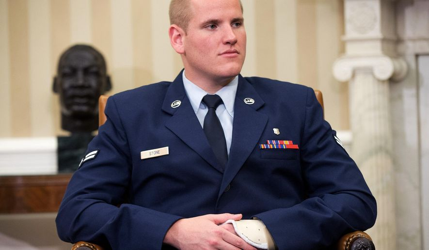 FILE - In this Sept. 17, 2015 file photo, Air Force Airman 1st Class Spencer Stone sits in the Oval Office of the White House during a meeting with President Barack Obama in Washington. An Air Force spokesman said on Thursday, Oct. 8, 2015, that Stone, who helped subdue an attacker on a Paris-bound train in August, is in stable condition after being stabbed in California. (AP Photo/Andrew Harnik, File)