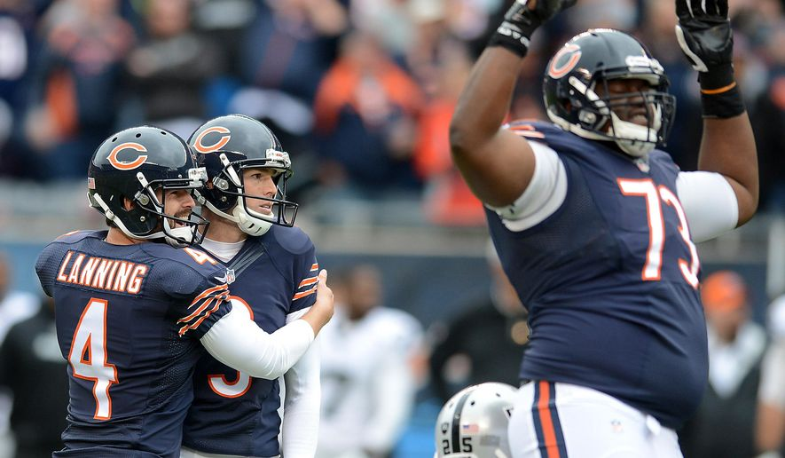 Chicago Bears kicker Robbie Gould (9) and holder Spencer Lanning (4) watch as his game-winning kick goes through the uprights during an NFL football game against the Oakland Raiders in Chicago, Sunday, Oct. 4, 2015. The Bears won 22-20. (Rick West/Daily Herald via AP) MANDATORY CREDIT, MAGS OUT, TV OUT