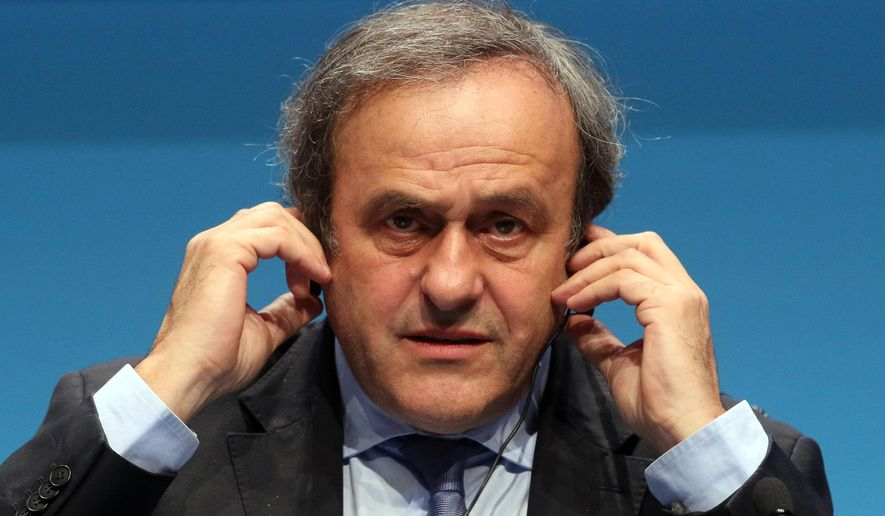 FILE - In this March 24, 2015 file photo UEFA President Michel Platini speaks during a news conference at the end of the 39th Ordinary UEFA Congress in Vienna, Austria. On Thursday, Oct. 8, 2015 file photo FIFA provisionally banned UEFA President Michel Platini for 90 days.(AP Photo/Ronald Zak, file)